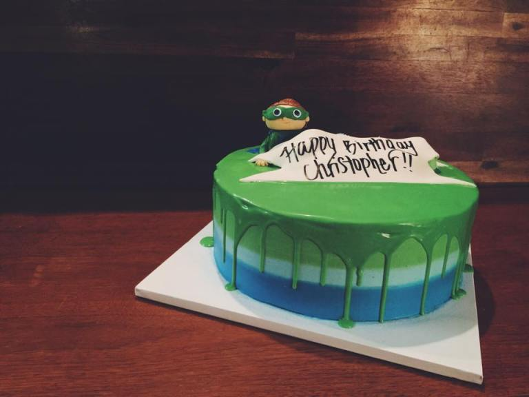 First Birthday Cake | - Vanilla Bean Cake - Vanilla Bean Ombre Buttercream - Green White Chocolate Ganache Drip - Super Why Boy made of Gumpaste - Fondant Ribbon