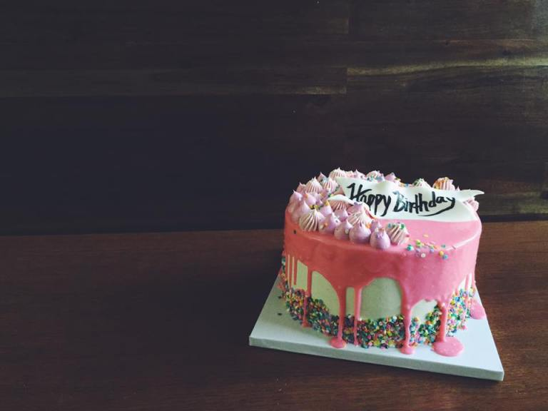 - Confetti Cake - Vanilla Bean Buttercream - Sprinkle Border - Pink Drip Ganache - Piped Buttercream Kisses - Fondant Ribbon